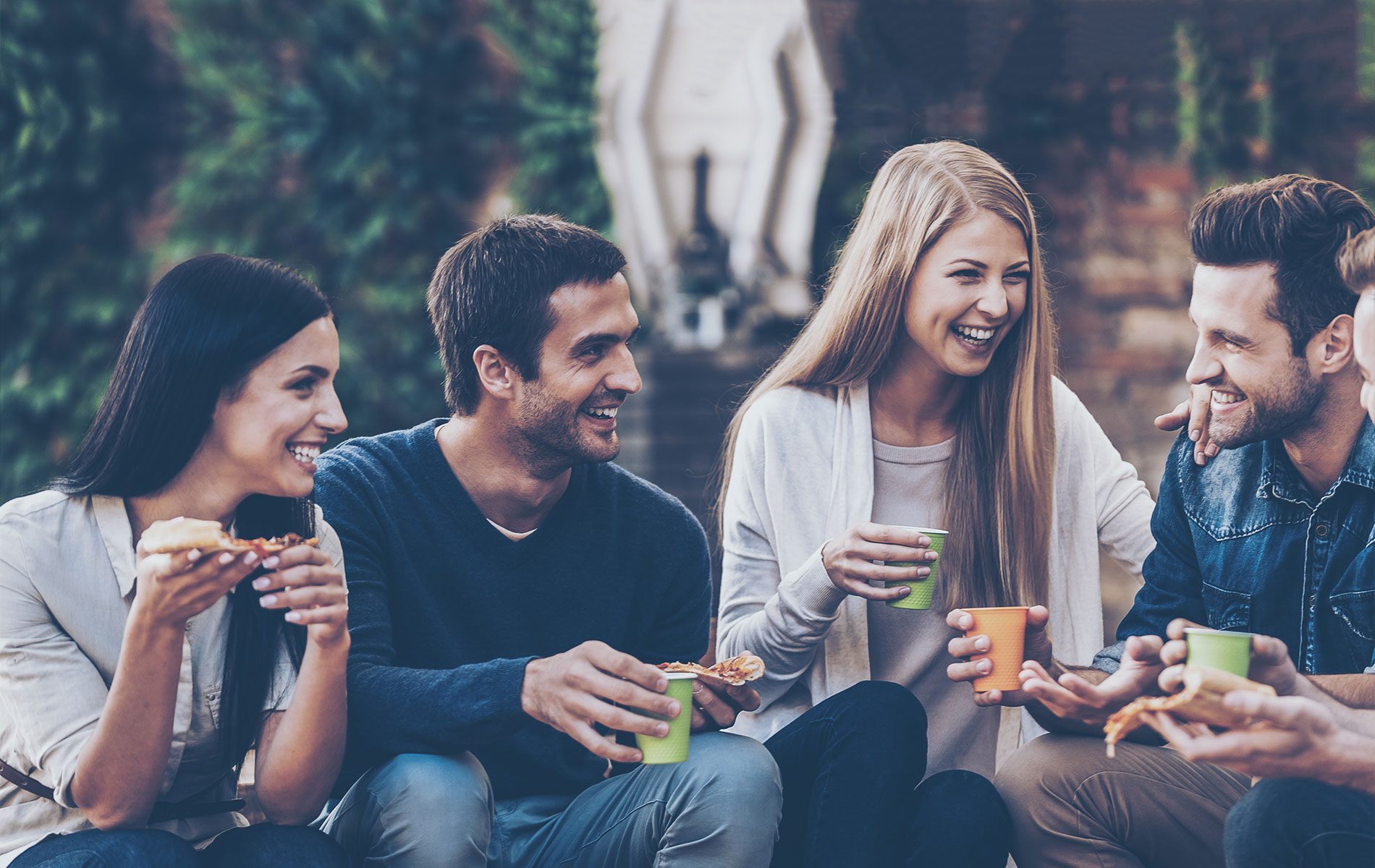 Group of friends enjoying drinks outdoors